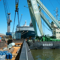 Direct export transhipment of transformer ex barge to seagoing vessel.