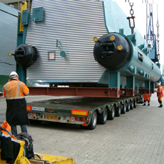Direct receipt ex vessel's hold, onto multi axle low-loader for inland transport.
